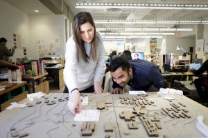 Students looking over an architectural model